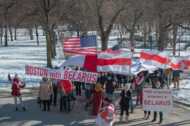 Marching to the State House, carrying red and white flags, the banner of the movement for democracy in Belarus.