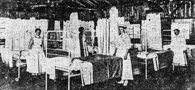 "Nurses hang curtains and make beds in the Worcester's Emergency Hospital to care for people suffering from the 1918 influenza epidemic. According to an Oct. 5, 1918, article in the Evening Gazette, the hospital was constructed in two days in a former Horticultural Society exhibition hall at the Greendale Fair Grounds. There were 60 beds, but ""With some extra work, 300 can be cared for,"" according to the article.  Inset image on wide displays"