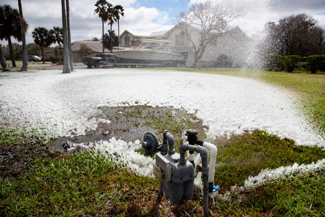 A broken water line sprays infant for a house on Ocean Boulevard in below freezing temperatures on Monday, Feb. 15, 2021.