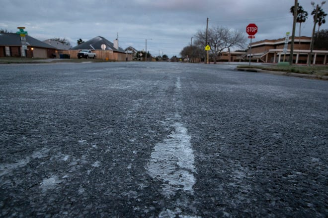 Ice built up on the road at Lipes Boulevard after a night of freezing rain and temperatures below freezing on Monday, Feb. 15, 2021.