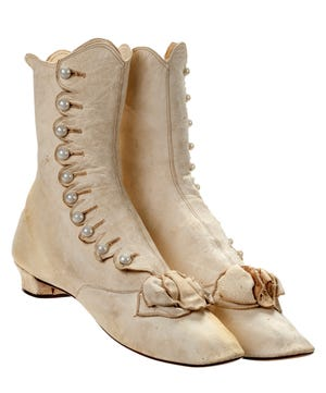 The buttoned boots, made sometime in the 1870s, are among the oldest pair of shoes in the Walk This Way exhibit from the Stuart Weitzman Collection.