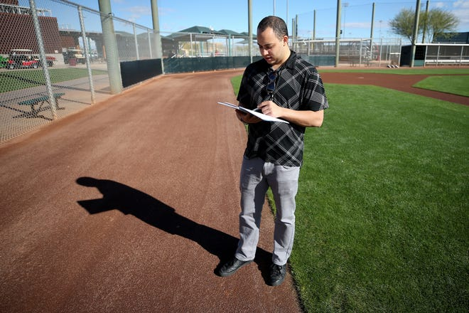 Cincinnati Enquirer Reds beat writer Bobby Nightengale takes notes as pitchers and catchers work out, Saturday, Feb. 16, 2019, at the Cincinnati Reds spring training facility in Goodyear, Arizona.