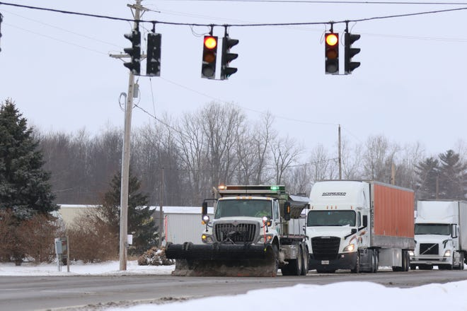 ODOT snow plows expect to be busy as they prepare for a major winter storm expected to affect Sandusky and Ottawa Counties through Tuesday. Traffic follows this plow at the intersection of U.S. 20 and U.S. 23 near Gibsonburg.