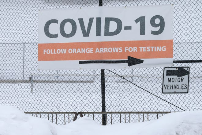 A sign directs individuals towards the COVID-19 test site at Happy Hollow Elementary, Monday, Feb. 15, 2021 in West Lafayette.