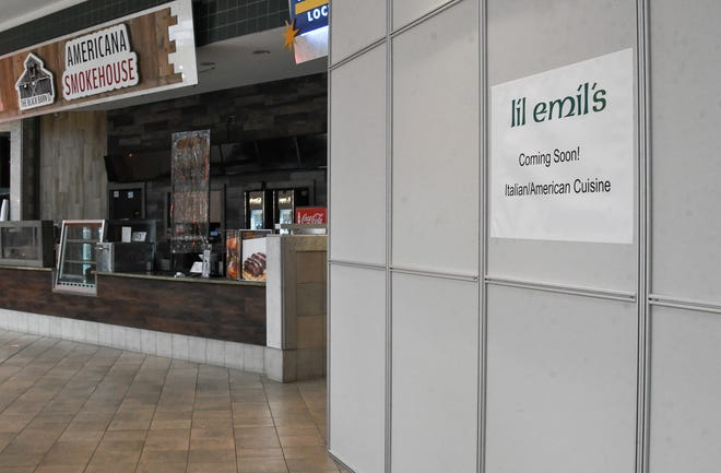 Signage inside the food court in the Meridian Mall, seen Monday, Feb. 15, 2021, indicating a new Italian/American restaurant coming to the mall food court.