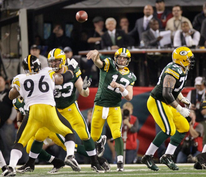 Green Bay Packers quarterback Aaron Rodgers throws a pass during the second half against the Pittsburgh Steelers in Super Bowl XLV in Arlington, Texas, on Sunday, Feb. 6, 2011.