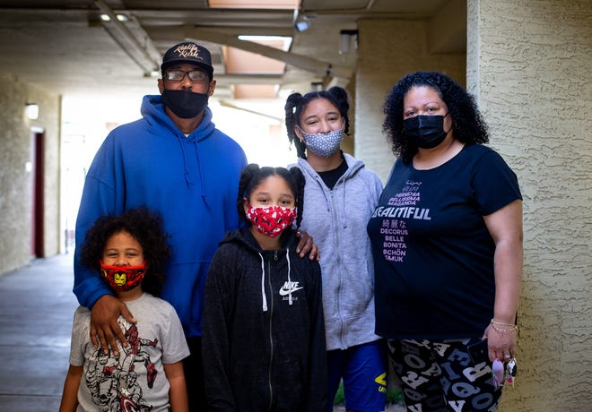 Robert Conley III (from left), Robert Conley, Renee Conley, Roberta Conley and Marisa Martinez-Conley at the UMOM New Day Centers in Phoenix on Feb. 15, 2021.