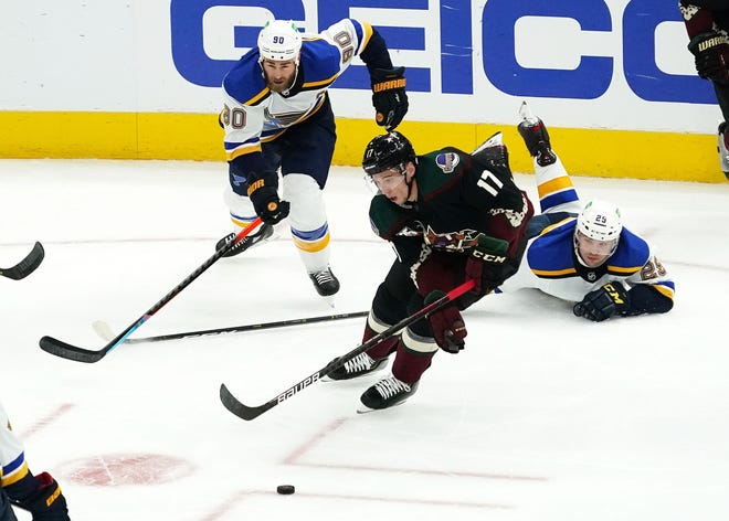 Feb 15, 2021; Glendale, Arizona, USA; Arizona Coyotes center Tyler Pitlick (17) chases the puck against St. Louis Blues defenseman Vince Dunn (29) in the first period at Gila River Arena. Mandatory Credit: Rob Schumacher-Arizona Republic