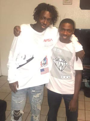 Phoenix police found Michael Loving Jr. (left), 16, dead in a car after he was shot on Jan. 25, 2021.