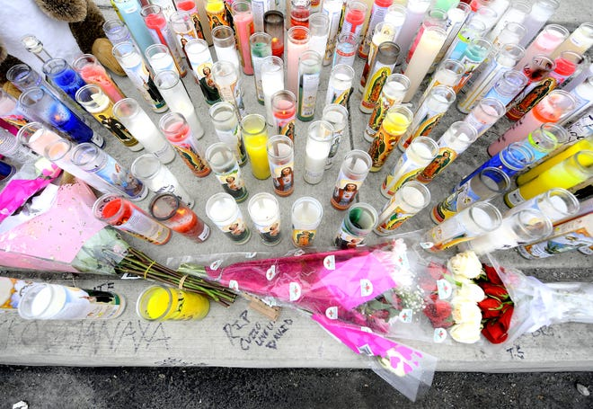 A candle memorial was created in the 1400 block of West Market Street, Monday, Feb. 15, 2021, after Angel Perez II, 30, was fatally shot at the location early Sunday morning. Bill Kalina photo