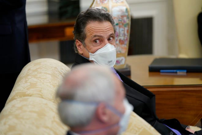 New York Gov. Andrew Cuomo attends a meeting with President Joe Biden and a bipartisan group of mayors and governors to discuss a coronavirus relief package, in the Oval Office of the White House, Friday, Feb. 12, 2021, in Washington.