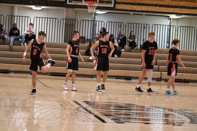 Dell Rapids takes the floor after a timeout against St. Thomas More at the Mitchell Corn Palace on Feb. 13, 2021.