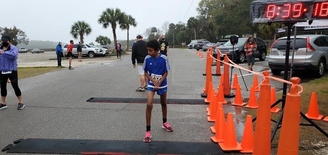 Johnathon Kiros, who runs for Deerlake Middle School, became the third member of the Kiros family to win the  Flash 6K race as he ran a time of 23:45 (6:22 pace).