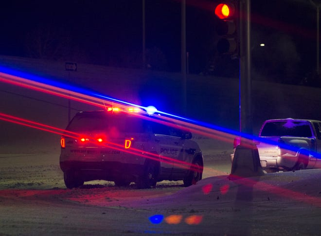 Wichita Falls Police helped keep traffic off a stranded motorist before dawn Monday on Kell Freeway near Harrison Street. Some traffic control lights around the city were out as the result of rolling blackouts imposed by the power company