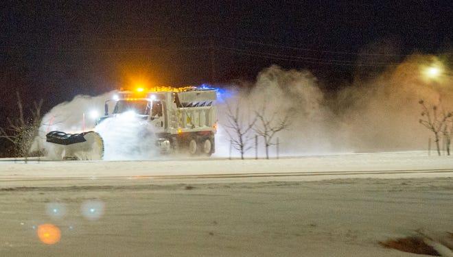 Texas Department of Public Transportation trucks plowed portions of Kell Freeway Monday morning.