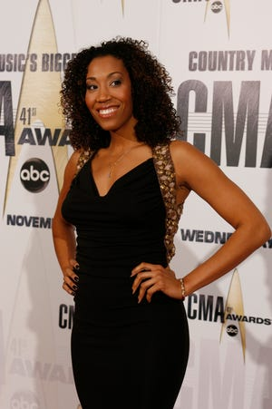 Rissi Palmer arrives for the 41st Annual CMA Awards at the Sommet Center.