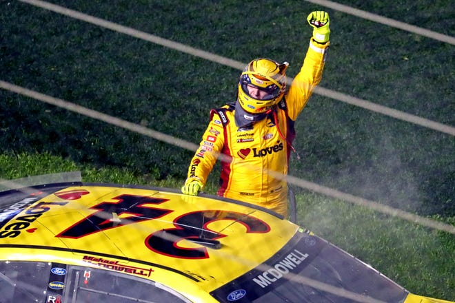 Michael McDowell celebrates after winning the 2021 Daytona 500.
