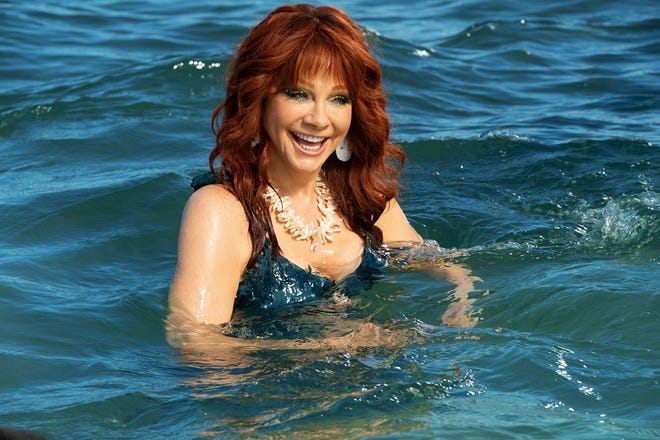 "Reba McEntire appears as the water spirit Trish, saving the day in ""Barb & Star Go to Vista Del Mar."""