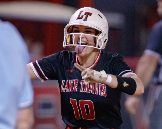 Lake Travis outfielder Emma Craver reacts after hitting her second home run of the game against Westlake in a district game last season. Craver is part of a veteran Cavalier squad that welcomes all but one starter from last season.