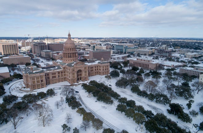 The Capitol grounds are covered in snow in downtown Austin on Monday February 15, 2021.