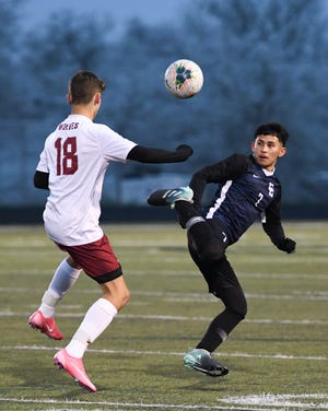 Cedar Creek's Jesse Martinez, right, moves the ball into the Weiss zone during the Eagles' 4-1 loss.