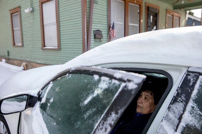 Maria Pineda warms up in her car outside her home on Garden Street in East Austin on Tuesday during a power outage caused by severe winter weather. Pineda said her home has been without power since early Monday.