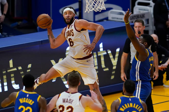 Cleveland Cavaliers center JaVale McGee (6) passes the ball against the Golden State Warriors during the first half of an NBA basketball game in San Francisco, Monday, Feb. 15, 2021. (AP Photo/Jeff Chiu)