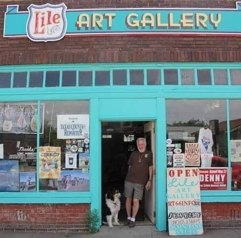 Bob Lile poses in front of his gallery located on Route 66.