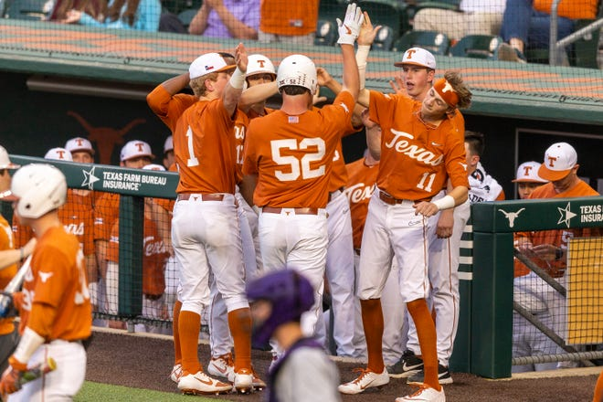 Texas first baseball Zach Zubia (52) celebrates a home run that he hit against Abilene Christian in Austin on March 11, 2020. Texas will open its 2021 season on Feb. 20.