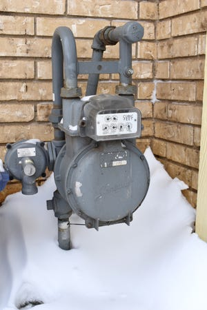 A gas meter at an Ardmore home is surrounded by snow Tuesday, Feb. 16, 2021.