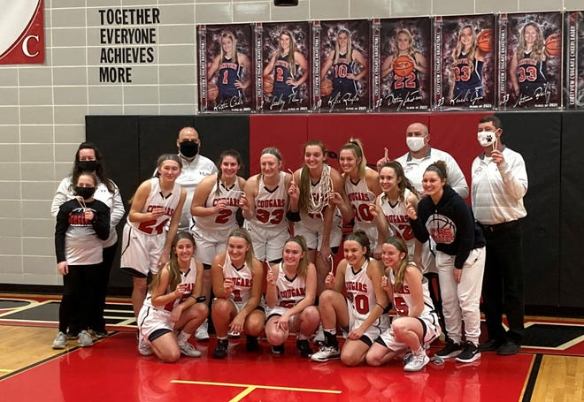 Crestview's girls basketball team poses for a picture after beating Western Reserve on Saturday. The win clinched the Cougars a share of their second consecutive Firelands Conference title.
