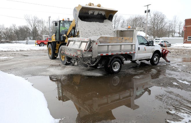 Ashland City Street Department employee Brian Honaker fills his truck with a new load of salt on Tuesday, Feb. 16, 2021. TOM E. PUSKAR/TIMES-GAZETTE.COM