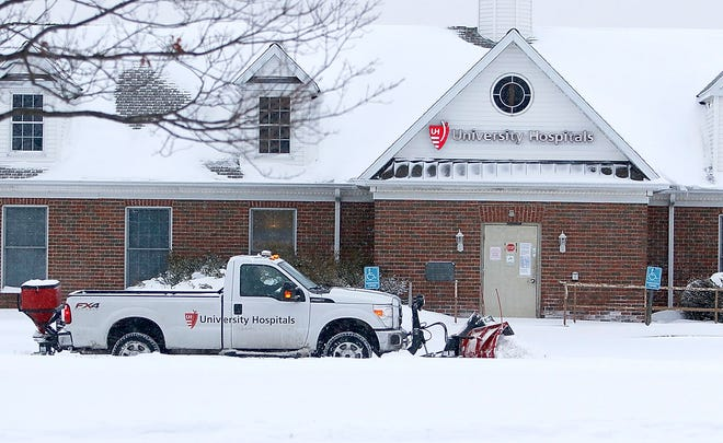 A University Hospitals snow plow clears the parking lot of the UH Medical Offices of Mid-Ohio Internal Medicine on the corner of Baney Road and U.S. 42 on Tuesday, Feb. 16, 2021. TOM E. PUSKAR/TIMES-GAZETTE.COM