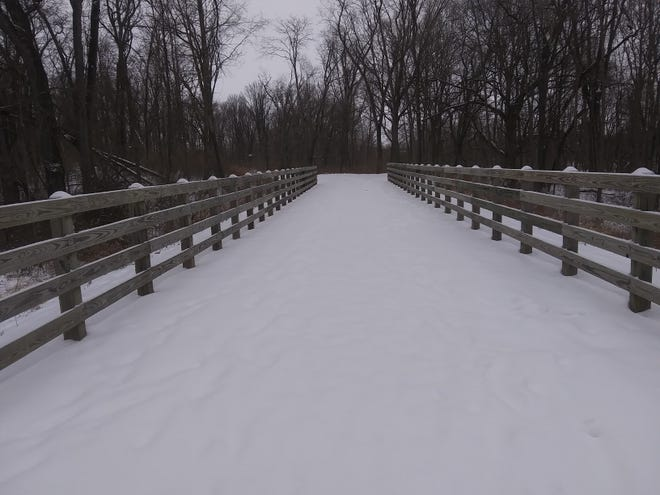 Pictured is a snowy trail to Lakeland Park on a wintery Monday.