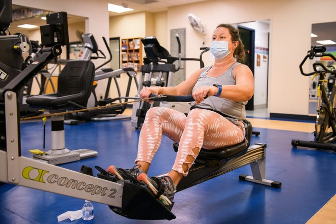 Julie Krause works out at MU Health Care's cardiac rehabilitation gym as she recovers from a heart attack she suffered in September. Krause hopes to return to her hobby of powerlifting as soon as possible.