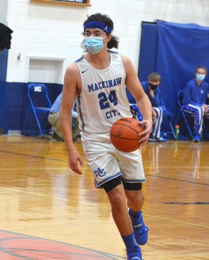 Mackinaw City senior Kal O'Brien (24) became the school's all-time leading scorer in a victory at Alba on Monday night.