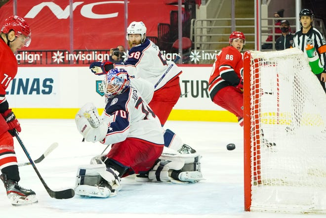 Carolina left wing Teuvo Terabainen (86) fires the go-ahead goal past Blue Jackets goaltender Joonas Korpisalo early in the second period of the Hurricanes' 7-3 win on Monday in Raleigh, N.C.