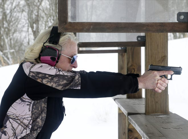 Judi Phelps, of On Guard Defense Training Center & Shooting Range in New Plymouth, demonstrates a stance on the outdoor shooting range. A sexual assualt survivor, Phelps teaches armed and unarmed self-defense classes for women, who account for a large portion of new gun owners. Phelps open-carries a Glock 26 9mm semi-automatic handgun.