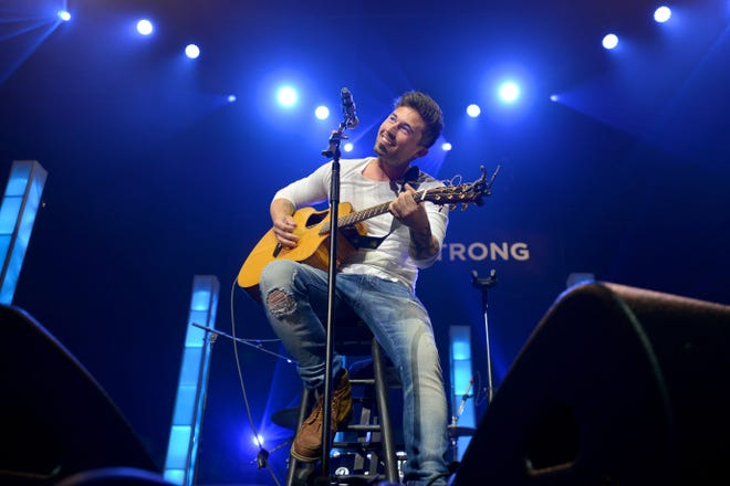 Michael Ray performs at the K92.3 Country Strong Benefit concert at the CFE Arena on Tuesday, June 22, 2016 in Orlando, Fla. Nine country artists came together for an acoustic concert to honor and remember the victims of the Pulse nightclub shooting. Proceeds from the event went to the OneOrlando fund. (Amber Riccinto/ Daily Commercial)