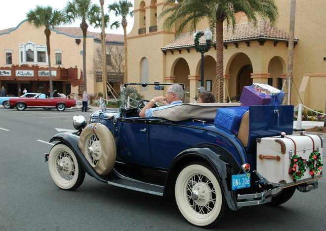 "Lynwood and Marie Leighton enter Spanish Springs Square at the Villages in their 1939 Model ""A Ford Roadster in 2014."