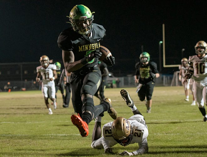 Lake Minneola's Duke Walker races past St. Augustine's Tyshawn Campbell (21) as he scores a touchdown on Dec. 11, 2020 in the Class 6A state semifinal game at Lake Minneola. Walker is the Daily Commercial All-Area Offensive Player of the Year. [PAUL RYAN / CORRESPONDENT]