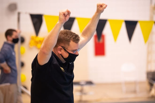 Wooster swimming coach Rob Harrington celebrates a victory.