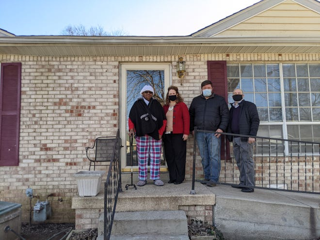 Augusta Walker (left) poses with First Farmers Chief Accounting Officer Jill Giles, Habitat for Humanity Critical Repair Manager Scott Barker and First Farmers Community Development Officer Marcus Houston in front of Walker's newly-renovated home on Jan. 28, 2021.