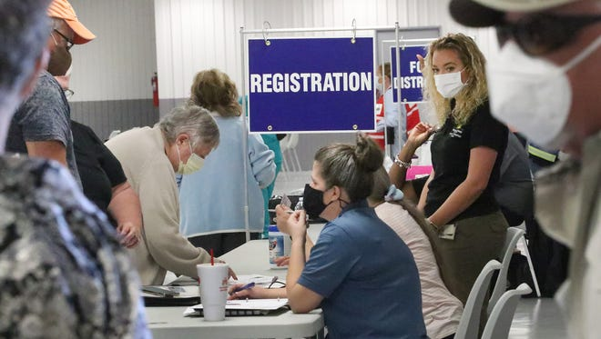 Residents check in for their COVID-19 vaccination appointments at the Elvin Daugharty Exhibit Hall at the Volusia County Fairgrounds on Tuesday, Feb. 16, 2021. Previously, the vaccines were given via drive-thru at the fairgrounds.