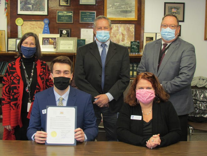 In honor of tomorrow's business leaders, the Wayne County Board of Commissioners proclaimed February 14-20 as National FBLA-PBL Week. Seated left to right, Leonard Maiocco III, Theresa Lubash. Standing left to right: Jocelyn Cramer, Brian Smith, Joseph Adams.