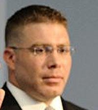 Justin W. Griffith, an Erie police officer since 2008, has been charged in a domestic dispute.
