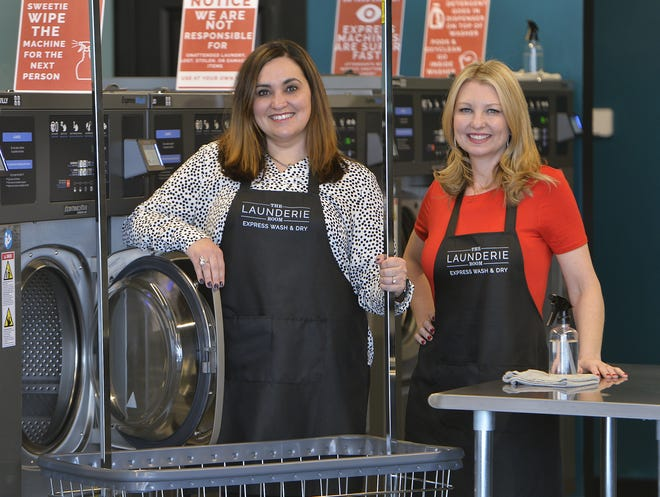 The Launderie Room owners Melissa Pagliari, 41, left, and Angela Magee, 43, are shown inside the new full-service laundry business at 2810 State St. in Erie.
