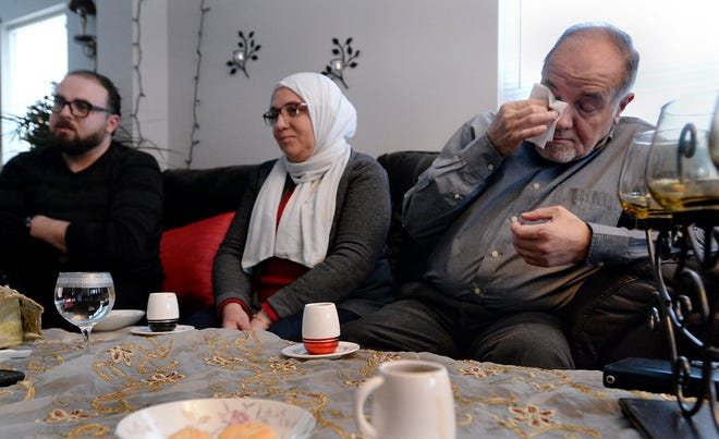 """In this Jan. 17, 2018, Erie Times-News file photo, Bassam Dabbah, far left, joins his mother Safwat Jarkas, then 55, and father Samir Dabbah, then 65, of Damascus Syria during an interview at their west Erie home. Samir Dabbah, who has since died, and Jarkas were resettled in Erie in early 2017 after a court blocked former President Donald Trump's so-called """"Muslim ban."""" Bassam Dabbah, now 40, said his two younger siblings, a brother and sister, were still living as refugees in Jordan when their father died two years ago. Those siblings, he said recently, """"gave up hope"""" of being resettled in the United States and moved to Turkey, where they no longer have refugee status."""