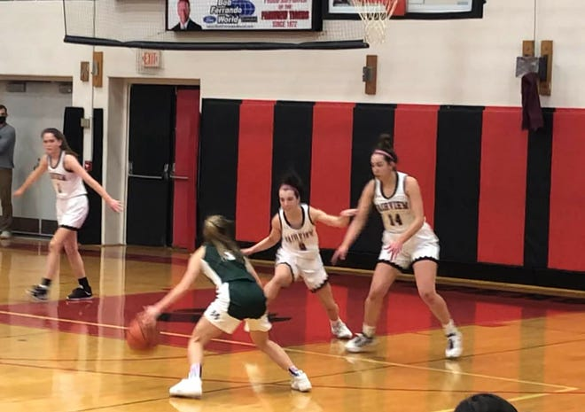 Mercyhurst Prep's Lillirose Lang steps back to attempt a 3-point shot as the first half ends against Fairview on Monday, Feb. 15, 2021 at Fairview High School. The Lakers won 38-35.