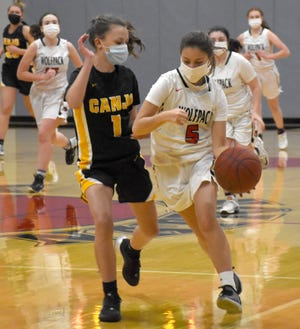 Oppenheim-Ephatah-St. Johnsville's Kirsten Swartz (right) rushes the ball up the court following a steal while Soren Veit-Scott (1) defends for Canajoharie Monday.